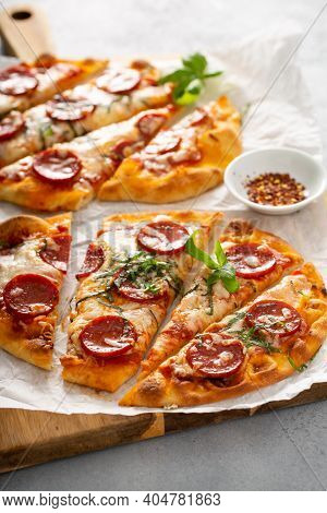 Flatbread Pepperoni Pizza Topped With Fresh Basil Sliced