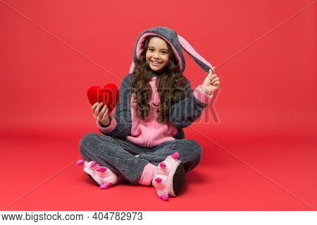 Therapy And Love. Happy Child In Bunny Pajamas Hold Red Heart. Cardio Diagnostics. Cardio Surgery. C