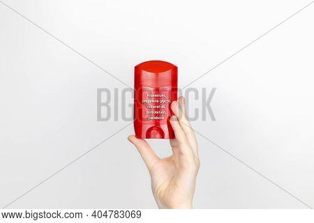 A Woman Examines The Harmful Ingredients Of The Antiperspirant. Stick Deodorant With Aluminum, Propy