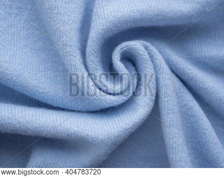 Simple Knitted Blue Cashmere Sweater. Pastel Blue Backdrop With Curves, Luxury Fashion. Smooth Elega