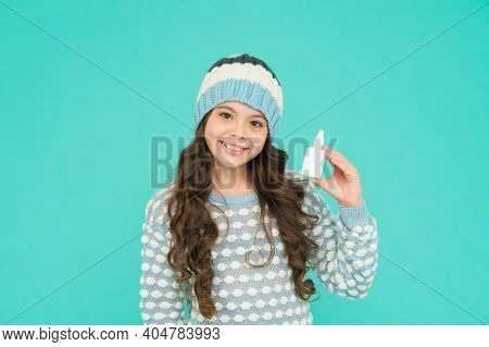 Childhood Healthcare. Teen Girl With Nasal Spray. No Addiction To Medicals. Smiling Kid In Warm Swea