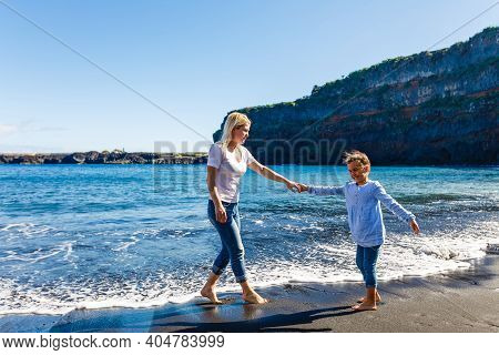 Family Holiday On Tenerife, Spain. Mother With Children Outdoors On Ocean. Portrait Travel Tourists