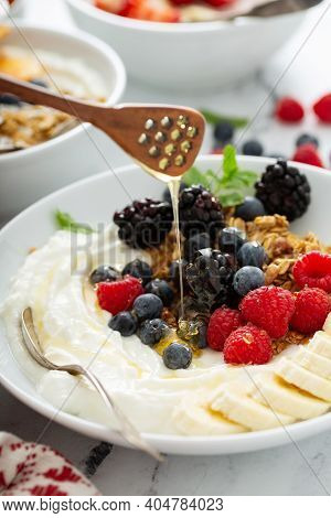 Yogurt Bowl With Mixed Berry, Fruit And Granola