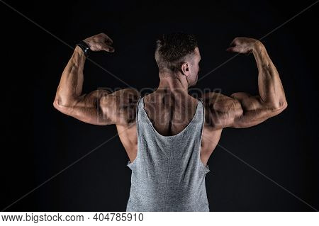 Lets Get That Body Trained. Fit Guy Flex Arms Showing Biceps Triceps. Muscle Power. Power And Streng