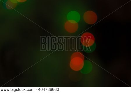 Defocused Image Of Illuminated Lights.boke. Lights On A Black Background. Defocused Image Of Illumin