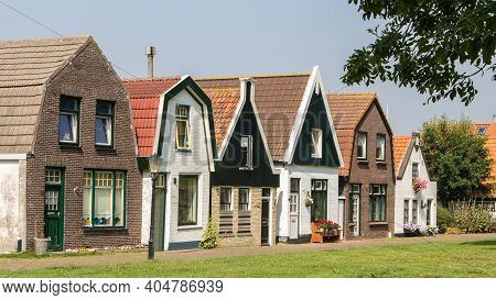 Texel, Netherlands - August, 2013: Row Of Traditonal Fishing Houses In Small Dutch Village Oude Schi