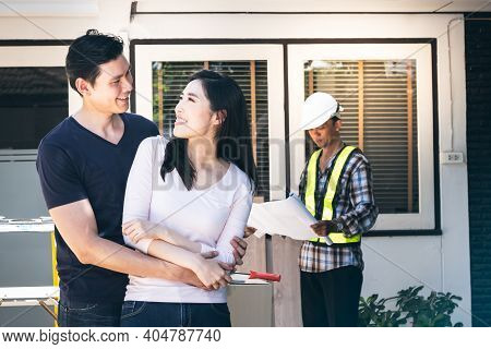 Asian Young Couple, Husband And Attractive Wife Are Happiness Together For Renovating The Old House