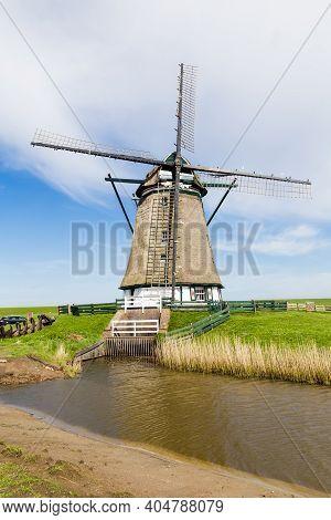 Dutch Windmill Het Noorden On The Wadden Island Texel In The Netherlands.