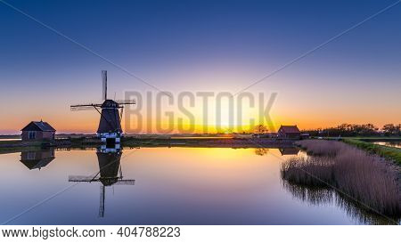 Dutch Windmill Het Noorden During Sunset On The Island Texel In The Netherlands