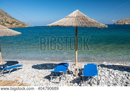 Crete Greece Plaka Lassithi With Is Traditional Blue Table And Chairs And The Beach In Crete Greece.