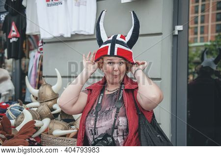 July 26, 2013. Oslo, Norway. A Female Tourist Wearing A Traditional Viking Hat With Horns Outdoors,