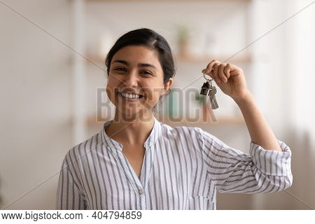 Young Mixed Race Woman Proud Homeowner Showing Keys Of Flat