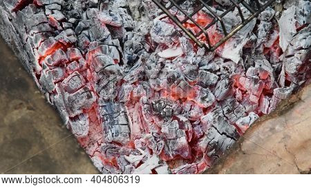 Natural Wooden Coals Burning For Barbecue, Smoldering And Glowing In Grill, For Preparing Grilled Fo