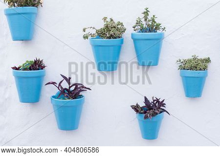 Blue Flowerpots On A White Wall In An Andalusian Old Town Mijas