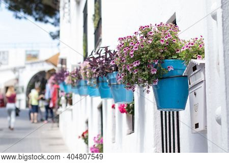 Blue Flowerpots In A Row On A White Wall In An Andalusian Old Town Mijas