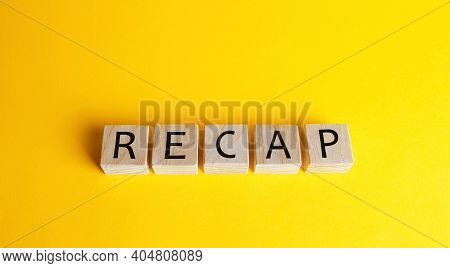 Wooden Blocks With The Word Recap. A Document Presenting Your Skills And Achievements. Getting A New