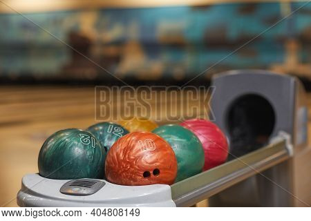 Background Image Of Several Bowling Balls On Rack In Bowling Alley Center, Copy Space