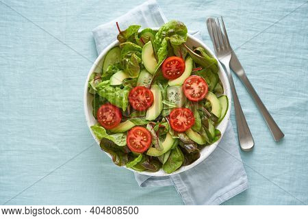 Vegan Salad With Tomatoes, Cucumbers, Avocado On Pastel Linen Tablecloth. Vegeterian Mediterranean F