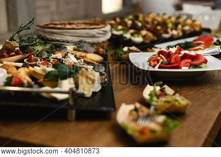 Wedding Candy Bar. A Festive Table Filled With Different Types Of Sweets. A Wedding Treat. Buffet Wi