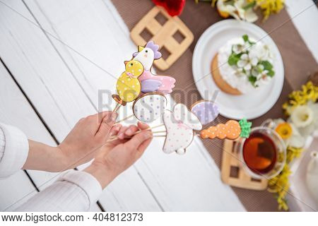 Close Up Of Bright Easter Gingerbread Cookies On Sticks. The Concept Of Decor For The Easter Holiday