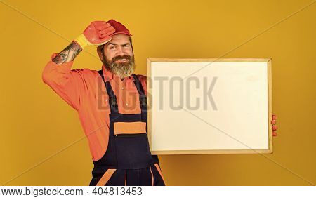 Conference Meeting. Person Presenting At A Flip-chart. Businessman. Male Construction Worker. Man Wi