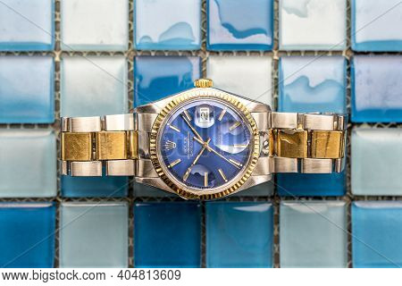 Rolex Oyster Blue Watch On Tiles Background