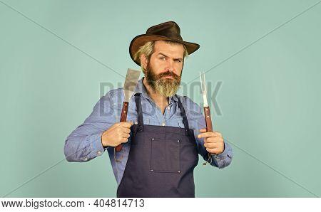 Bbq Food. Tools Roasting Meat. Man In Apron Hold Barbecue Grill. Farmer Promoting Bbq Equipment. Coo