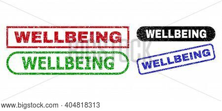 Wellbeing Grunge Stamps. Flat Vector Grunge Seal Stamps With Wellbeing Tag Inside Different Rectangl