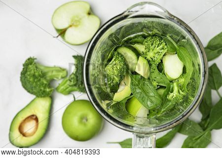 Cooking Healthy Detox Green Smoothie With Fresh Vegetables And Fruits In Blender. Healthy Detox Brea