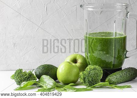 Green Healthy Detox Smoothie With Fresh Vegetables And Fruits In Blender On White Background. Health
