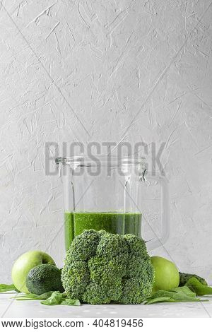 Green Healthy Detox Smoothie With Fresh Vegetables And Fruits In Blender On White Background. Vertic