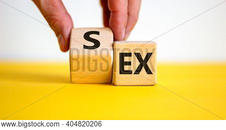 Sex With An Ex Symbol. Hand Turns A Cube And Changes The Word 'ex' To 'sex'. Beautiful Yellow Table,