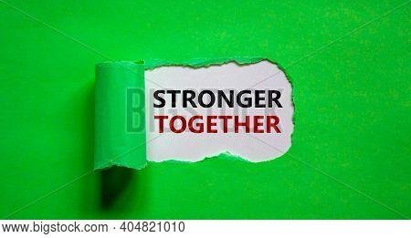 Stronger Together Symbol. Words Stronger Together Appearing Behind Torn Green Paper. Business, Motiv