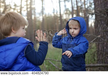 True Men Friendship, Outing Of Crowed Places. Two Kids Giving High Five Each Other For Support