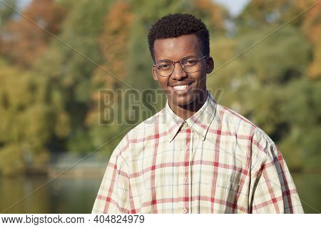 Portrait Of Handsome Happy Black African Afro American Young Man In Shirt And Glasses Standing Outdo