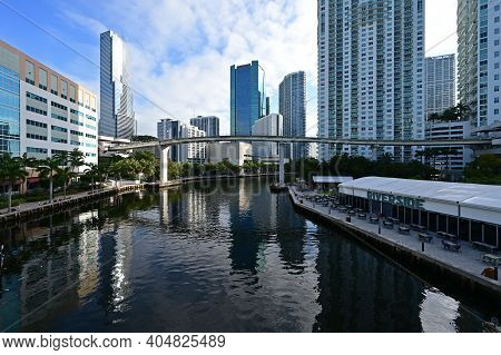 Miami, Florida 01-24-2021 Residential And Office Towers Reflected In Calm Water Of Miami River On Ea