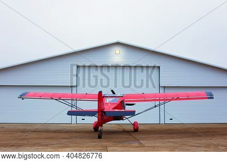 Small Single Prop Engine Aircrafts Planes Parked Inside Workshop Hangar With Closed Door. Private Ul