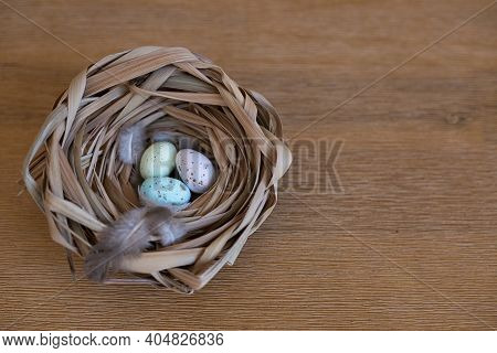 Easter Eggs Lie In The Nest. Colorful Eggs. Easter Greeting Card. Small Multi-colored Testicles In A