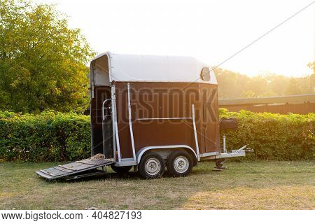Horse Trailer Standing Outdoor With Open Door. Vehicle For Horse Transportation Travel With Animals
