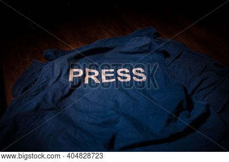Media Journalism Global Daily News Content Concept. Blue Journalist (press) Vest In Dark With Backli