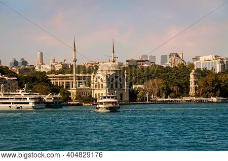 View On The Bank Of Bosporus Strait With Touristic Boat Departing From Kabatas Ferry Terminal In Fro