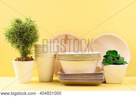 Biodegradable, Compostable, Disposable Or Eco Friendly Utensil (plate, Dish, Bowl, Cup) On Yellow Ba