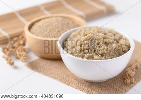 Cooked Brown Quinoa Seeds And Raw Quinoa Seeds In A Bowl, Healthy Vegan Food