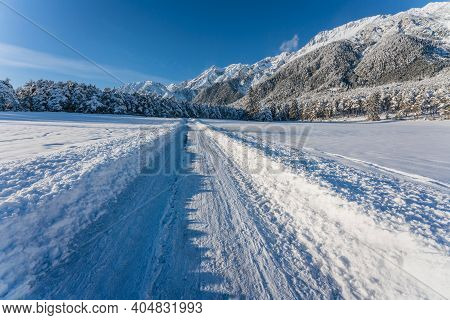 Deep Snow Covered Walking Path Through Sunny Alpine Winter Landscape In Wildermieming, Tirol, Austri