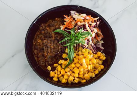 Healthy Plant-based Food Recipes Concept, Vegan Nourish Bowl With Mexican Beans Corn Avocado And Dai