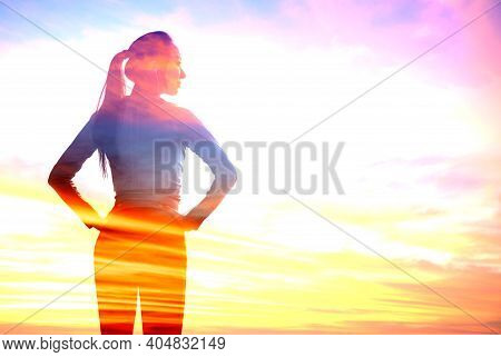 Double Exposure Of Young Sporty Woman With Colorful Sunset Cloud Background