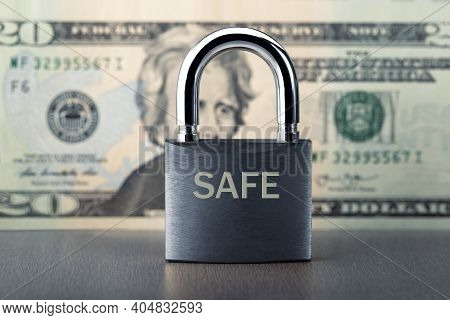Financial Security Concept. Protection Of Finance With Lock And Dollar Banknote.