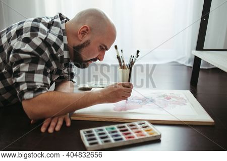 Man Drawing Laying On The Floor Of Design Studio