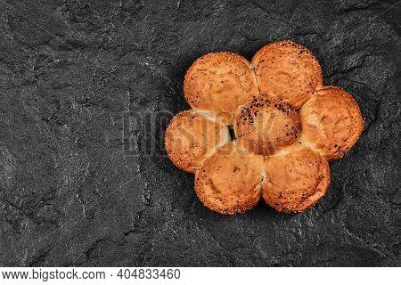 Fresh Wheaten Bread Shaped Like Flower On Dark Background
