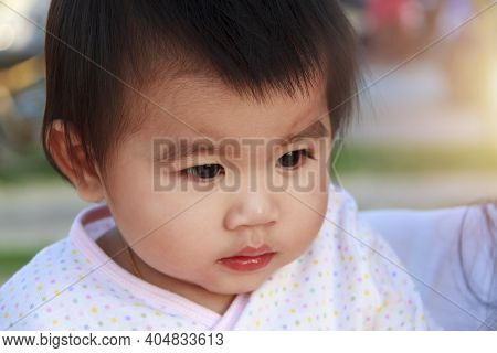 Close Up Portrait Little Girl. Cute Adorable Asian Little Girl Play In Park With Sun Ray Background.